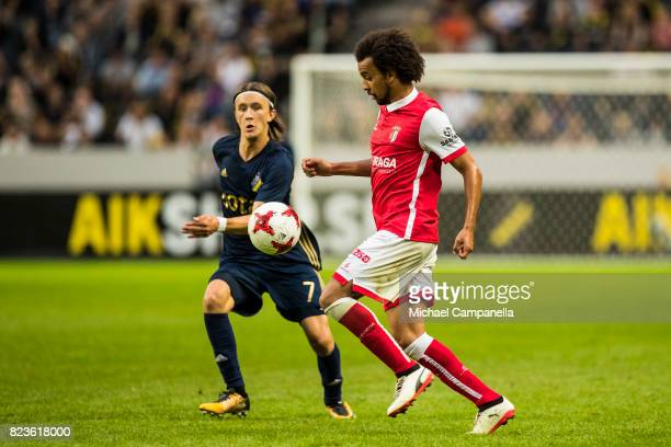 Kristoffer Olsson of AIK in a duel with Fabio Santos Martins of SC Braga during a UEFA Europa League qualification match between AIK and SC Braga at...