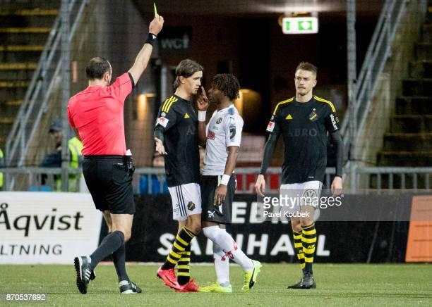 Kristoffer Olsson of AIK Kennedy Igboananike of Orebro SK during the Allsvenskan match between Orebro SK AIK at Behrn Arena on November 5 2017 in...