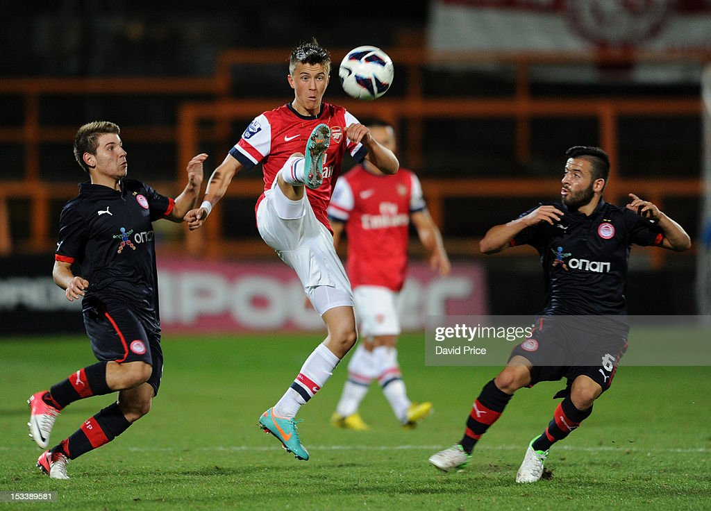 Kristoffer Olsson of Arsenal controls the ball under pressure from Dimitrios Voutsiotis and Emmanouil Siopos of Olympiacos during the NextGen Series match between Arsenal U19 and Olympiacos U19 at Underhill Stadium on October 4, 2012 in Barnet, United Kingdom.