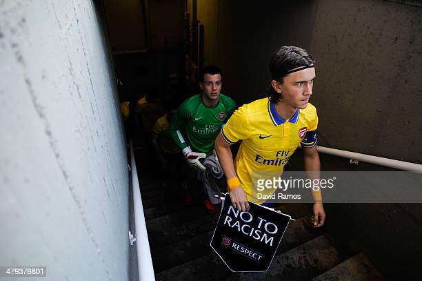 Kristoffer Olsson of Arsenal leads his team out onto the pitch prior to the UEFA Youth League Quarter FInal match between FC Barcelona U19 and...