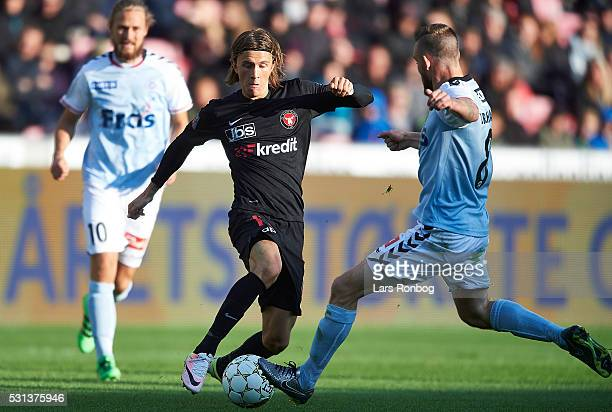 Kristoffer Olsson of FC Midtjylland and Janus Drachmann of Sonderjyske compete for the ball during the Danish Alka Superliga match between FC...