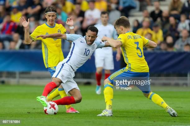 Kristoffer Olsson of Sweden Jacob Larsson of Sweden and Lewis Baker of England battle for the ball during the UEFA European Under21 Championship...