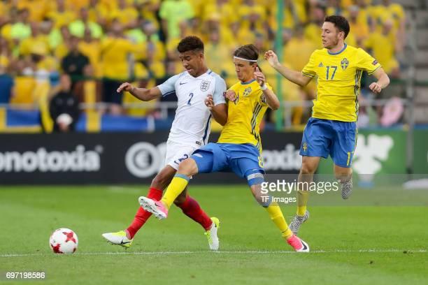 Kristoffer Olsson of Sweden Kerim Mrabti of Sweden and Mason Holgate of England battle for the ball during the UEFA European Under21 Championship...