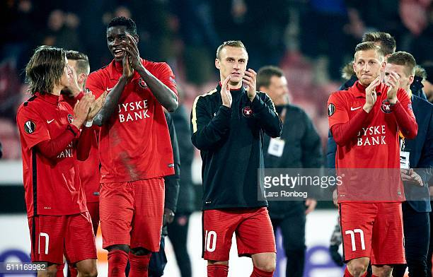 Kristoffer Olsson Paul Onuachu Martin Pusic and Daniel Royer of FC Midtjylland celebrate with the fans after the UEFA Europa League match between FC...