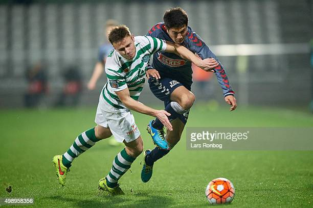 Kristoffer Pallesen of Viborg FF and Dzhamaldin Khodzhaniazov of AGF Aarhus compete for the ball during the Danish Alka Superliga match between...
