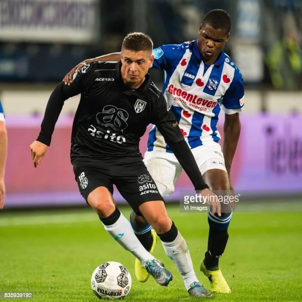Kristoffer Peterson of Heracles Almelo Denzel Dumfries of sc Heerenveen during the Dutch Eredivisie match between sc Heerenveen and Heracles Almelo...