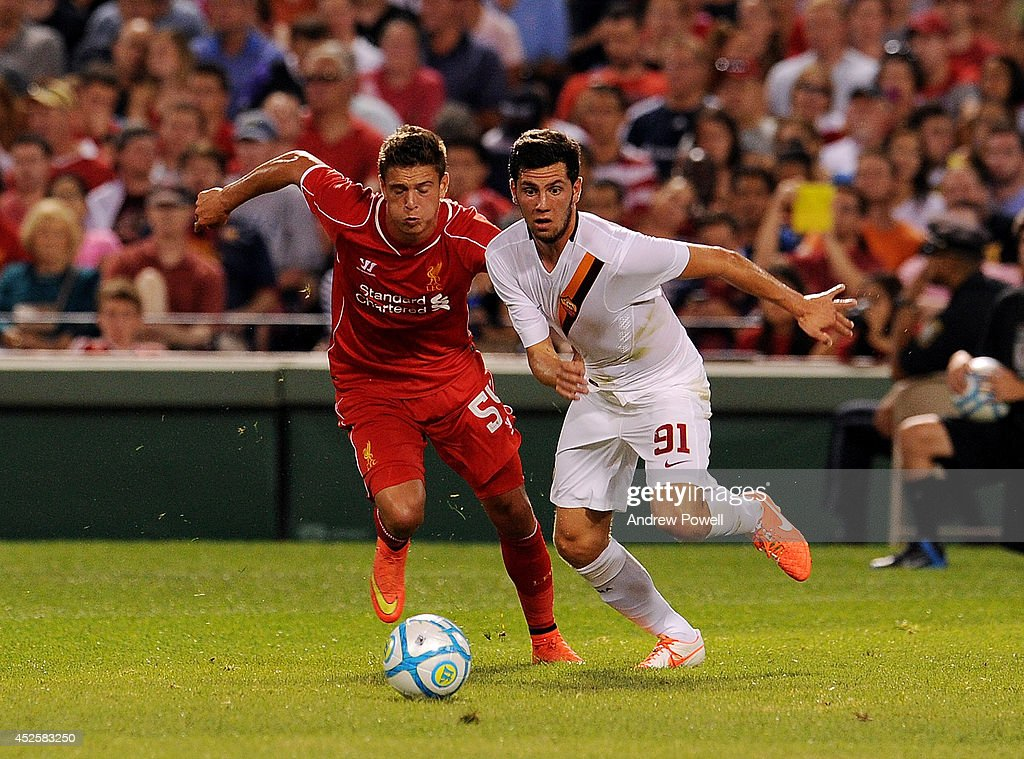 Kristoffer Peterson of Liverpool competes with Arturo Calabresi AS Roma during the pre-season friendly match between Liverpool FC and AS Roma at Fenway Park on July 23, 2014 in Boston, Massachusetts.