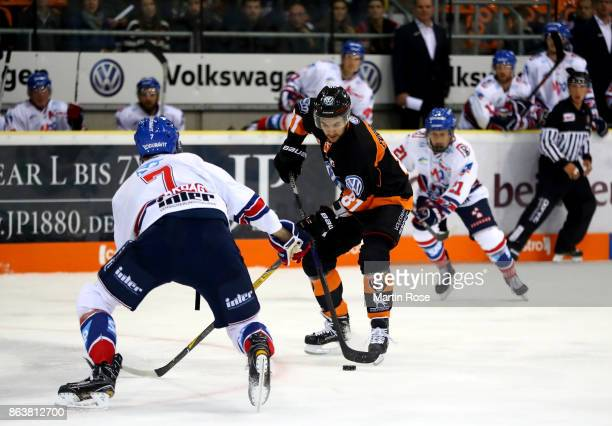 Kristopher Foucault of Wolfsburg and Sinan Akdag of Mannheim battle for the puck during the DEL match between Grizzlys Wolfsburg and Adler Mannheim...