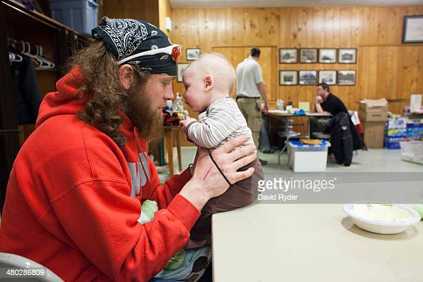 Kristopher Langton shares a moment with his son Kristian Langton at a temporary Red Cross shelter at the Darrington Community Center in Darrington...