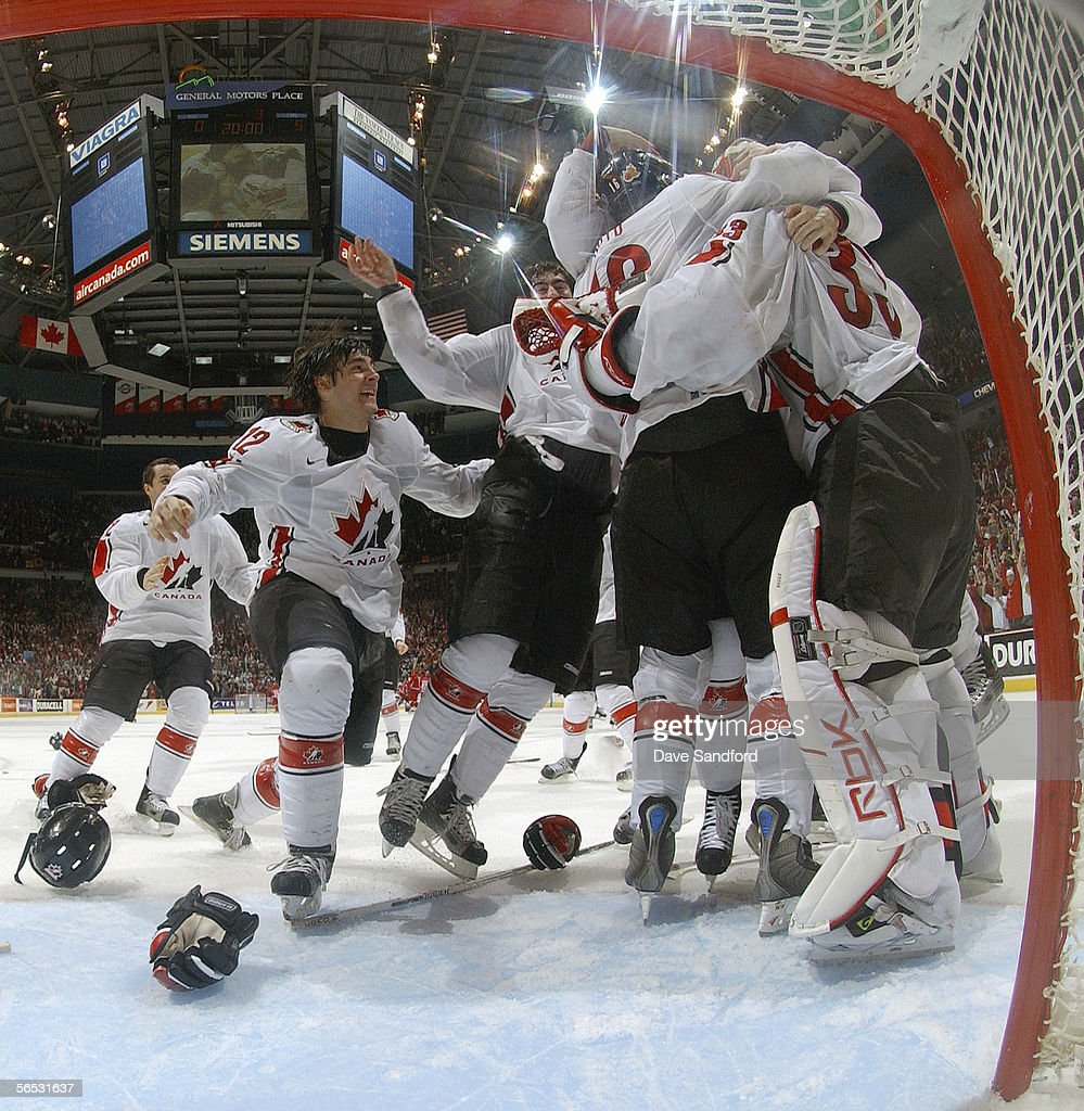 Kristopher Letang of Team Canada and teammates crowd around goaltender Justin Pogge after defeating Team Russia 50 in their World Junior Hockey...