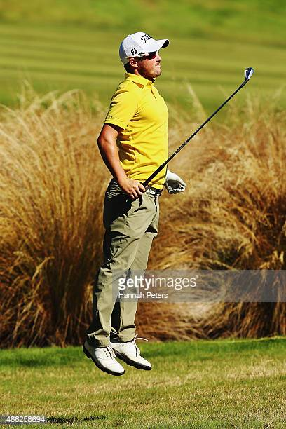 Kristopher Mueck of Australia jumps up to see the green during day four of the New Zealand Open at The Hills Golf Club on March 15 2015 in Queenstown...