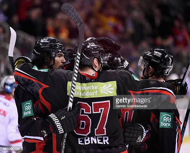Kristopher Sparre of Duesseldorfer EG celebrates with team mates as he scores the second goal during the DEL Ice Hockey game between Duesseldorfer EG...