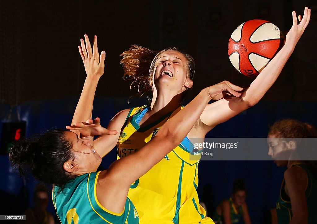 Kristy Wallace of Australia Gold competes with Mikayla Pirini of Australia Green in the Women's gold medal playoff during day four of the Australian Youth Olympic Festival at Sydney Boys High School on January 19, 2013 in Sydney, Australia.