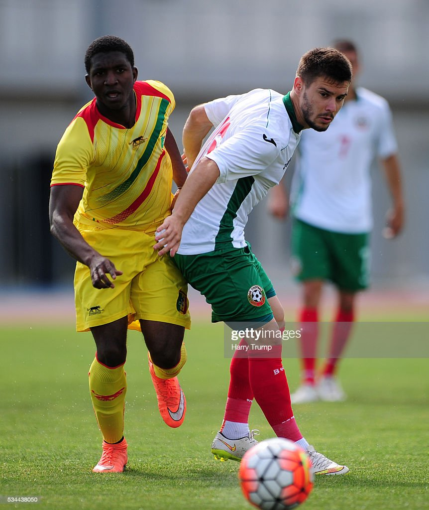 Kristyan Malinov of Bulgaria is tackled by Issa Baradji of Mali during the Toulon Tournament match between Mali and Bulgaria at the Stade Leo Lagrange on May 26, 2016 in Toulon, France.