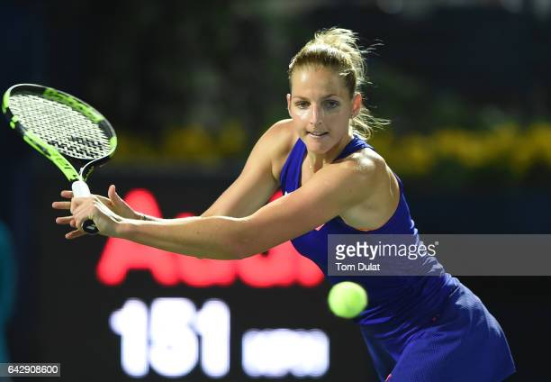 Kristyna Pliskova of Czech Republic plays a backhand against Roberta Vinci of Italy during day one of the WTA Dubai Duty Free Tennis Championship at...