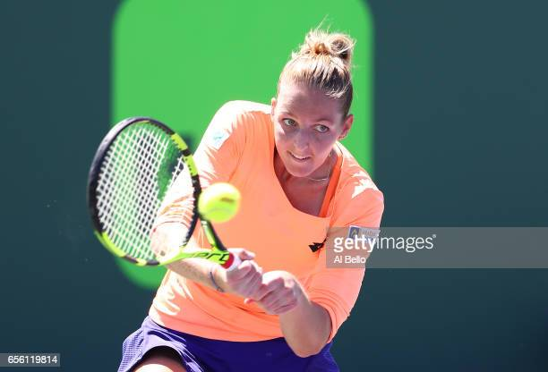 Kristyna Pliskova of the Czech Republic plays a backhand against Mandy Minella of Luxenburg during Day 2 of the Miami Open at Crandon Park Tennis...
