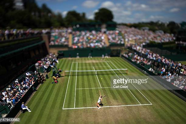 Kristyna Pliskova of the Czech Republic serves against Monica Niculescu of Romania during their Ladies Singles third round match on day 6 of the...