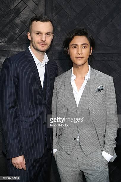 Krisvanassche and Chen Kun attend the Dior Menswear Fall/winter 20152016 on January 24 2015 in Paris France