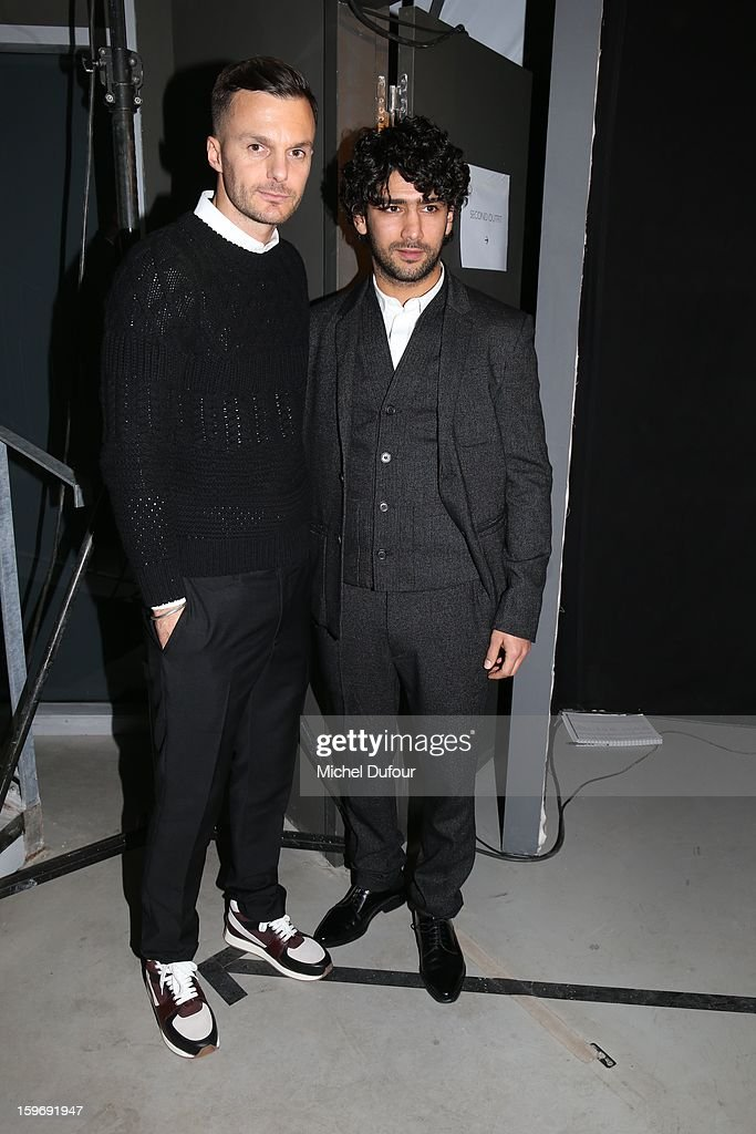 Krisvanassche and Salim Kechiouche is seen on the front row during the Krisvanassche Men Autumn / Winter 2013 show as part of Paris Fashion Week on at Palais De Tokyo on January 18, 2013 in Paris, France.