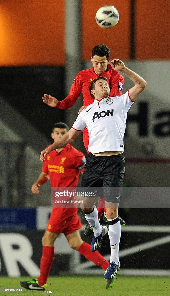 Krisztian Adorjan of Liverpool goes up with Nick Powell of Mnachester United Reserves during the Barclays Premier Reserve League match between Liverpool Reserves and Manchester United at Langtree Park on February 25, 2013 in St Helens, England.