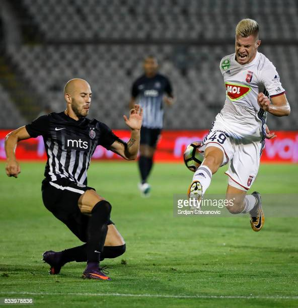 Krisztian Geresi of Videoton in action against Nemanja Miletic of Partizan during the UEFA Europa League Qualifying PlayOffs round first leg match...