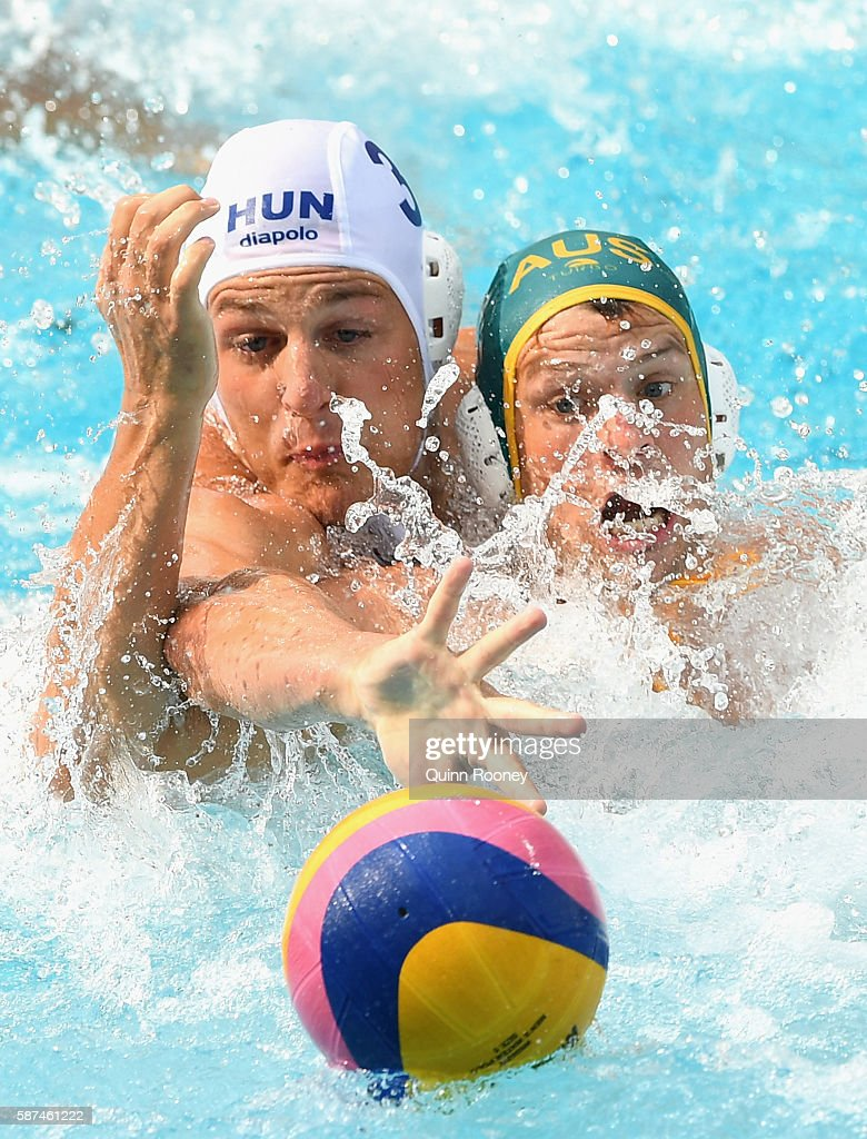 Krisztian Manhercz of Hungary and Jarrod Gilchrist of Australia compete for the ball during the Men's Prelimimary Round Group A match between the United States of America and Spain on Day 3 of the Rio 2016 Olympic Games at Maria Lenk Aquatics Centre on August 8, 2016 in Rio de Janeiro, Brazil.