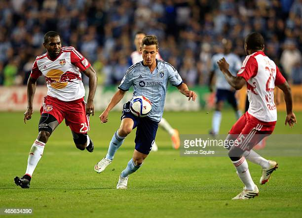 Krisztian Nemeth of Sporting KC controls the ball as Ronald Zubar and Chris Duvall of New York Red Bulls defend during the game at Sporting Park on...