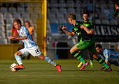 Krisztian Simon of 1860 Muenchen battles for the ball with Stephen Kingsley of Swansea during the preseason friendly match between TSV 1860 Muenchen...