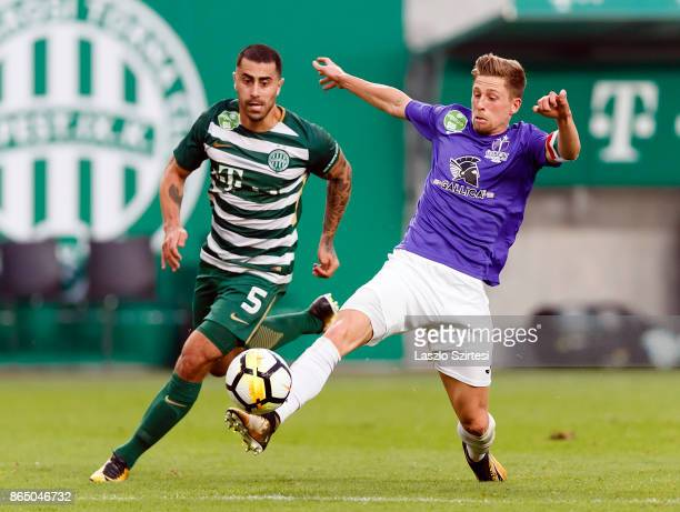 Krisztian Simon of Ujpest FC controls the ball next to Marcos Pedroso of Ferencvarosi TC during the Hungarian OTP Bank Liga match between...