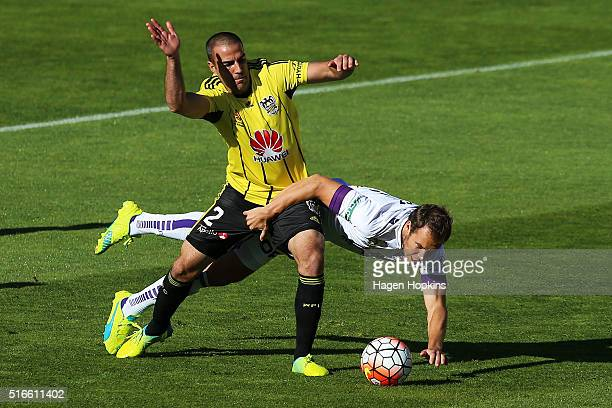 Krisztian Vadocz of the Glory loses his footing while challenging Manny Muscat of the Phoenix during the round 24 ALeague match between the...