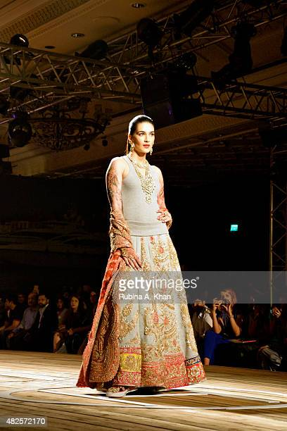 Kriti Sanon models couture collection for the Fashion Design Council of India's Amazon India Couture Week 2015 on day three centred around a nautical...