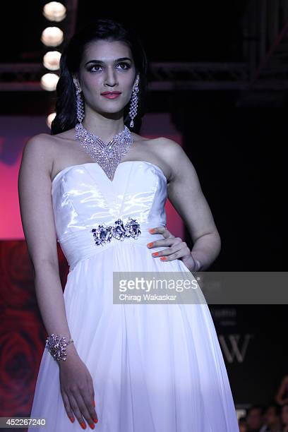 Kriti Sanon walks the runway at the Mahabir Jrwellers show during day three of the India International Jewellery Week 2014 at Grand Hyatt on July 16...