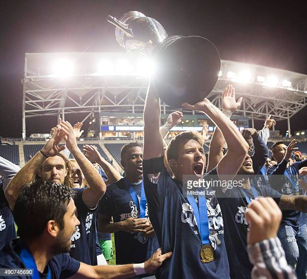 Krizstian Nemeth of Sporting Kansas City holds up the Lamar Hunt trophy after defeating the Philadelphia Union in the US Open Cup Final on September...