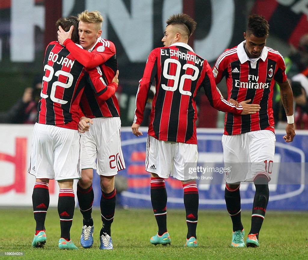 Krkic Bojan (L) with his teammates of AC Milan celebrates after scoring the opening goal during the Serie A match between AC Milan and AC Siena at San Siro Stadium on January 6, 2013 in Milan, Italy.