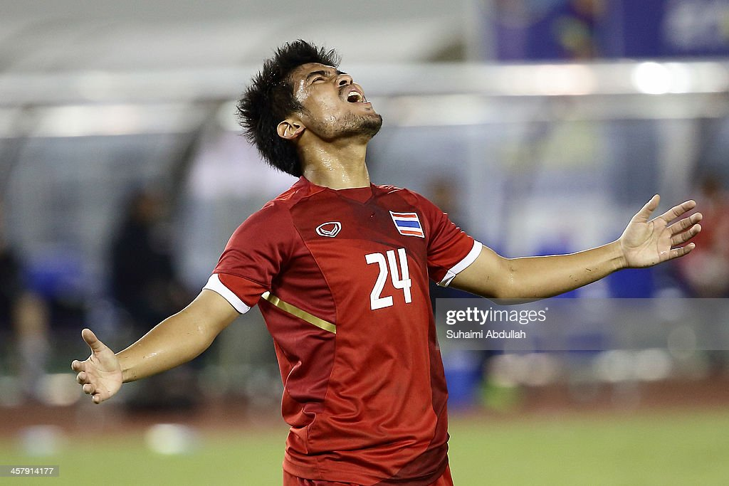 Kroeknit Thawikan of Thailand reacts after missing a goal during the semi-final football competition between Thailand and Singapore during the 2013 Southeast Asian Games at Zayar Thiri Stadium on December 19, 2013 in Nay Pyi Taw, Myanmar.