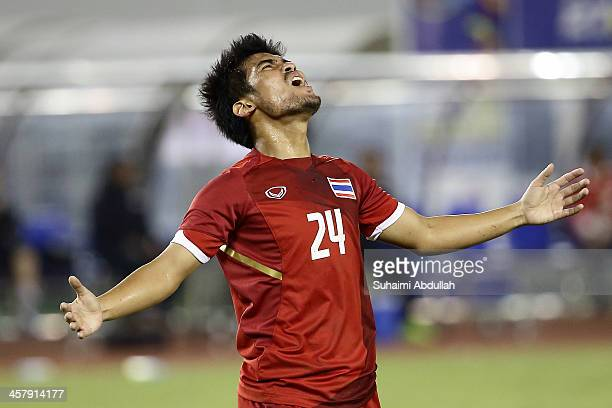 Kroeknit Thawikan of Thailand reacts after missing a goal during the semifinal football competition between Thailand and Singapore during the 2013...