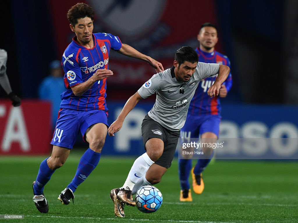 Kroekrit of Chonburi FC and Ha Daesung of FC Tokyo compete for the ball during the AFC Champions League playoff round match between FC Tokyo and Chonburi FC at the Tokyo Stadium on February 9, 2016 in Chofu, Japan.