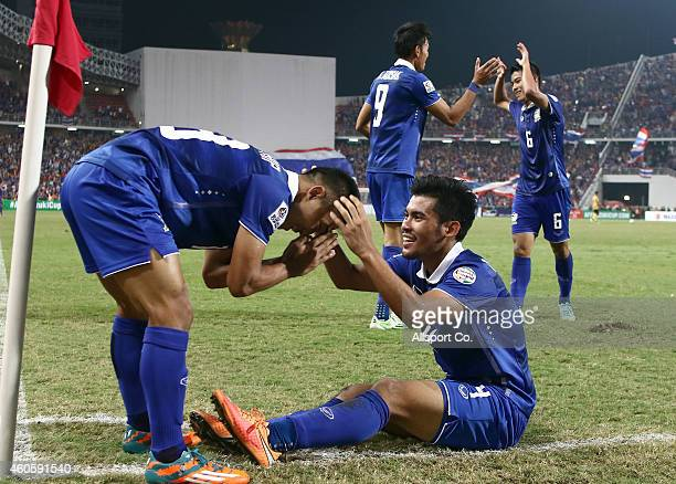Kroekrit Thawikan of Thailand celebrates with his teammates after scoring the 2nd goal against Malaysia during the 2014 AFF Suzuki Cup final 1st leg...