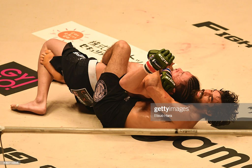 Kron Gracie(R) of Brazil secures rear choke submission in the bout against Tatsuya Kawajiri of Japan during the RIZIN Fighting World GP 2016 final round at Saitama Super Arena on December 31, 2016 in Saitama, Japan.