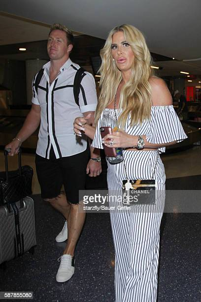 Kroy Biermann and Kim Zolciak are seen at LAX on August 09 2016 in Los Angeles California