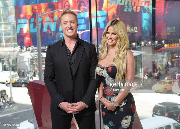 Kroy Biermann and television personality Kim Zolciak visit 'Extra' at HM Times Square on October 3 2017 in New York City