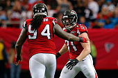 Kroy Biermann celebrates with Tyson Jackson of the Atlanta Falcons during the first half against the Carolina Panthers at the Georgia Dome on...