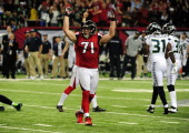 Kroy Biermann of the Atlanta Falcons celebrates after the game winning field goal against the Seattle Seahawks during the NFC Divisional Playoff Game...