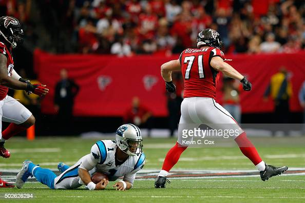 Kroy Biermann of the Atlanta Falcons celebrates sacking Cam Newton of the Carolina Panthers during the first half at the Georgia Dome on December 27...