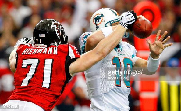 Kroy Biermann of the Atlanta Falcons forces a fumble by quarterback Chad Pennington of the Miami Dolphins at Georgia Dome on September 13 2009 in...