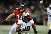 Kroy Biermann of the Atlanta Falcons grabs the facemask of Khiry Robinson of the New Orleans Saints during the fourth quarter of a game at the...