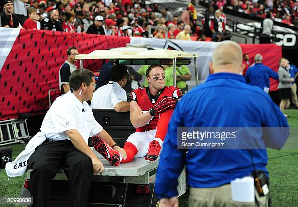 Kroy Biermann of the Atlanta Falcons heads off the field after being injured against the St Louis Rams at the Georgia Dome on September 15 2013 in...