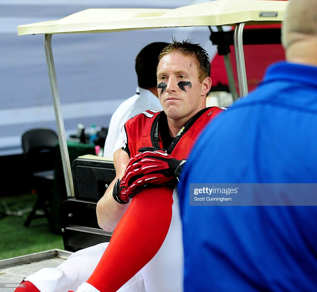 Kroy Biermann #71 of the Atlanta Falcons heads off the field after being injured against the St. Louis Rams at the Georgia Dome on September 15, 2013 in Atlanta, Georgia.