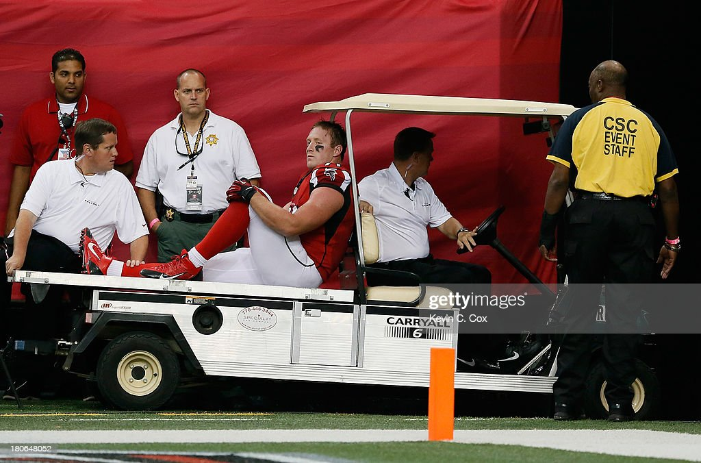 Kroy Biermann #71 of the Atlanta Falcons is carted off the field during the game against the St. Louis Rams at Georgia Dome on September 15, 2013 in Atlanta, Georgia.