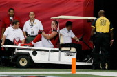 Kroy Biermann of the Atlanta Falcons is carted off the field during the game against the St Louis Rams at Georgia Dome on September 15 2013 in...